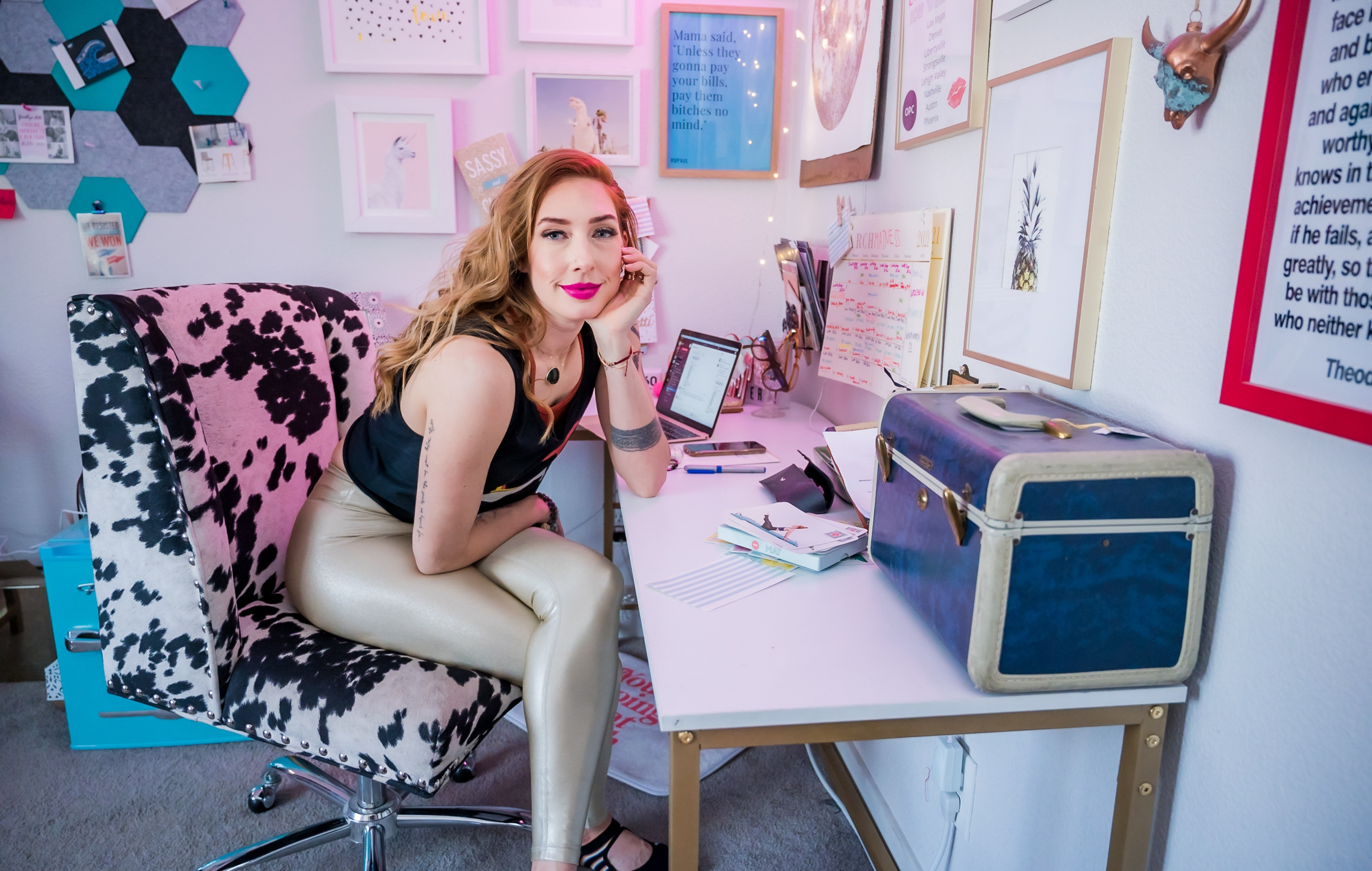 Lesley Logan, Pilates business/studio owner smiling while sitting in front of her working desk